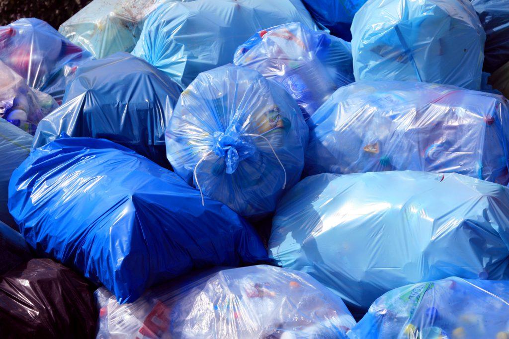 Commercial waste in blue bin bags